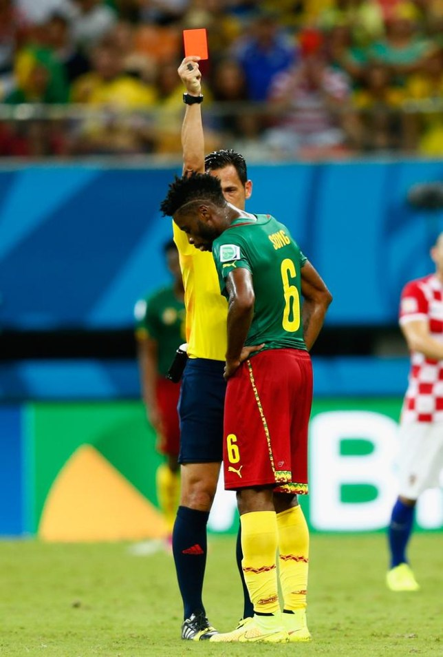 MANAUS, BRAZIL - JUNE 18: Alex Song of Cameroon is shown a red card by referee Pedro Proenca during the 2014 FIFA World Cup Brazil Group A match between Cameroon and Croatia at Arena Amazonia on June 18, 2014 in Manaus, Brazil. Phil Walter/Getty Images