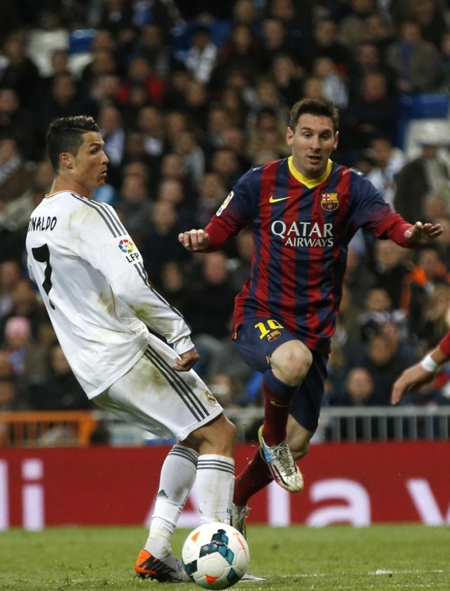 Barcelona's Lionel Messi (R) and Real Madrid's Cristiano Ronaldo challenge for the ball during La Liga's second 'Clasico' soccer match of the season at Santiago Bernabeu stadium in Madrid March 23, 2014. REUTERS/Sergio Perez (SPAIN - Tags: SPORT SOCCER) Sergio Perez/Reuters