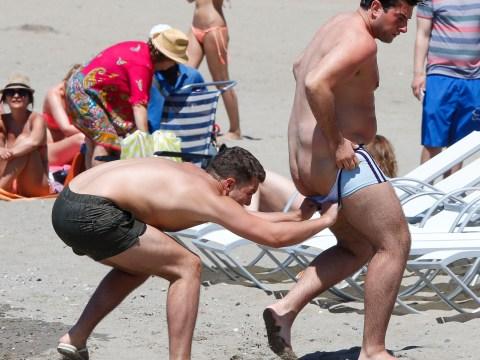 Bikini clad TOWIE babes invade Marbella beach in heels