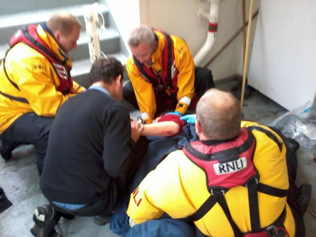 RNLI handout photo of RNLI crew members Craig Burns (left), David Norman (3rd left), Neil Withers (right) attending an injured person onboard the Millennium Diamond as nine people were injured when the pleasure boat crashed into Tower Bridge. PRESS ASSOCIATION Photo. Issue date: Wednesday June 4, 2014. Emergency services attended the scene after the Millennium City Cruises vessel collided with the north side of the famous London bridge at around midday. Five women had to be taken to hospital, while a man and a girl made their own way to get medical treatment and two other women were checked at the scene but did not require further assistance.  One of the women was taken as a priority to Royal London Hospital with pelvis and head injuries, while the other injuries sustained were described as minor. See PA story ACCIDENT Bridge. Photo credit should read: RNLI/PA Wire   NOTE TO EDITORS: This handout photo may only be used in for editorial reporting purposes for the contemporaneous illustration of events, things or the people in the image or facts mentioned in the caption. Reuse of the picture may require further permission from the copyright holder.