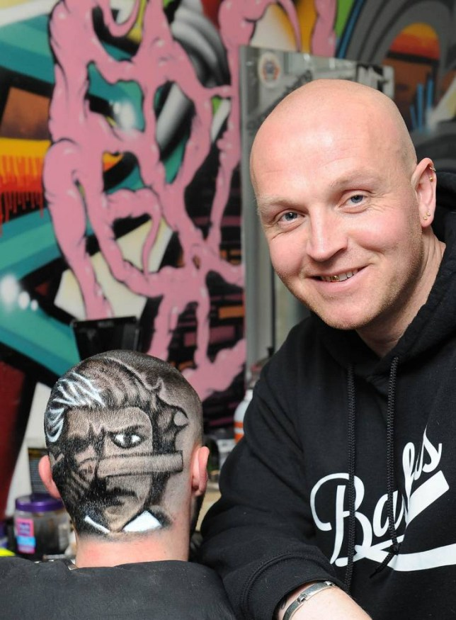 Pic shows..  A barber is proving to a be a cut above the rest creating extraordin-HAIRY artwork on people's heads. Snipper Paul Devlin, 36, has been creatively coiffuring customer's barnets with a passion that started when he was just 14 years old. The award-winning barber - who runs Devro⿿s Barbers, in Barrow, Cumbria - charges just £20 for his master-hair-pieces and has competed at the British Barbering Association Patterns Masters final. Incredibly despite his amazing designs - which include well-known cartoon characters - Paul recently returned to his local Furness College to study a Level 3 apprentice barbering qualification. Pictured is Paul with his completed design. SEE COPY.