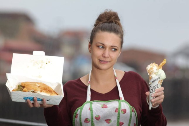 Nicole Plant, 27, samples Teare Wood Ice Cream Parlour's new flavour, Fish and Chip ice cream.  See Ross Parry copy RPYICE :  The ice cream consists of a scoop of chip flavour, a scoop of minted mushy pea flavour and a scoop of fish flavour rolled in scraps, all served in a cone with a chip as a flake.  Owner Shane Teare of Whitby created the flavours and has experimented with others such as corned beef flavour and garlic.