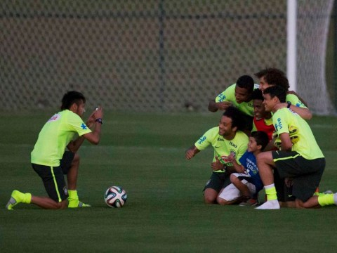 Aww! Neymar brings young pitch invader in for brilliant photo with Brazil team-mates