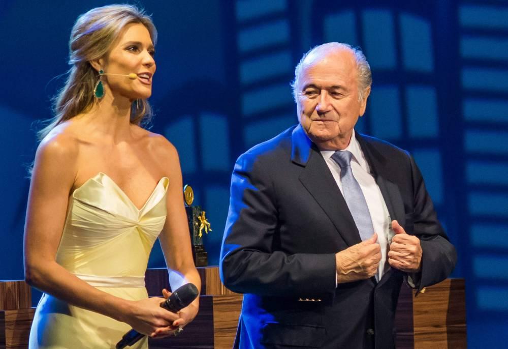 epa04248692 President of FIFA Joseph Blatter (R) next to Brazilian hostess and model Fernanda Lima (L) during the inaugural ceremony of the 64th  Congress of the FIFA in Sao Paulo, Brazil, 10 June 2014.  EPA/SEBASTIAO MOREIRA