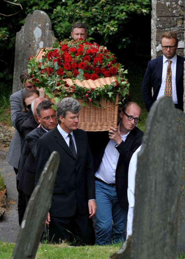 Adrian Edmonson (front right) helps carry the coffin of Rik Mayall from St George's church in Dittisham, Devon, following his funeral service. PRESS ASSOCIATION Photo. Picture date: Thursday June 19, 2014. The private ceremony for the star, who died last week aged 56, will be followed by a memorial service which is expected to be held in September. See PA story FUNERAL Mayall. Photo credit should read: Nick Ansell/PA Wire