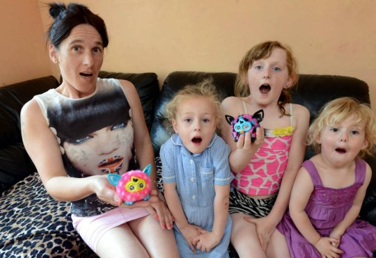 """Louise Wilkinson with (L-R) Tia, Monet and Shannon.  A shocked mum was furious after a talking kids toy she bought her nine-year-old daughter taught her to say: """"F**k you.""""  See NTI story NTIFURBY.  Mother Louise Wilkinson, 42, bought two of the £15 popular Furby toys as a treat  for her daughter Monet and her grandkids Tia, four, and Shannon, three.  But she was stunned when she got them back to her home in Llanfyllin, Powys, and opened up the packaging on Monday (23/6).  The mum-of-three claims one of the two little bundles of fluff blurted out the words: """"F**k you"""" after pressing the button on its back.  And now she says her young daughter want stop wont stop repeating the obscenities while walking around the house."""