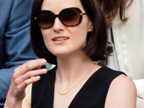 'My hero': Downton Abbey's Michelle Dockery sings to mourners at her beloved fiance's funeral