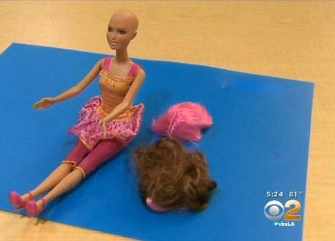 Not just a pretty face: Mattel's 'chemo' Barbie helps young girls battling cancer