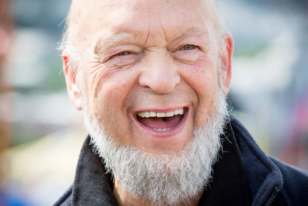 Michael Eavis speaking at a press conference atop a hill at Glastonbury Festival in Somerset. June 29 2014.