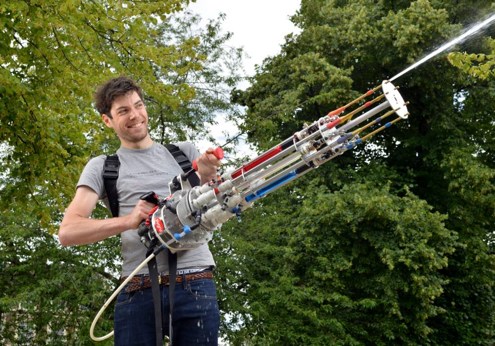 Worlds most sophisticated water pistol made by sugru is put to the test.  Pictured: Design engineer Alex Bygrave