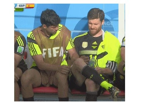 Diego Costa tries to wax Xabi Alonso's leg on Spain bench against Australia