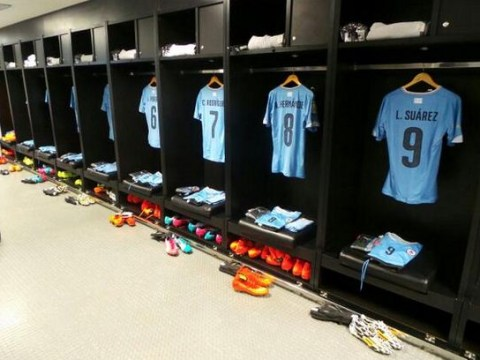 Luis Suarez's full kit continues to hang in Uruguay's dressing room – despite ban from the World Cup