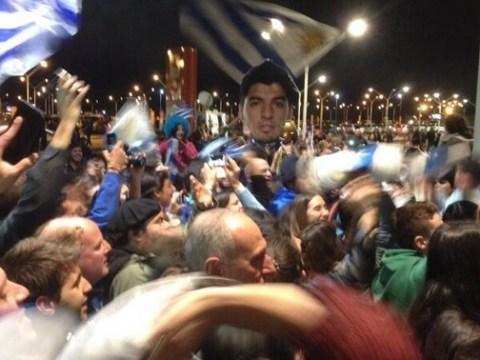 Uruguay fans wait at airport to welcome home disgraced Luis Suarez
