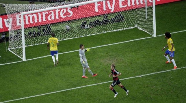 Germany's Toni Kroos, bottom, celebrates scoring his side's 3rd goal during the World Cup semifinal soccer match between Brazil and Germany at the Mineirao Stadium in Belo Horizonte, Brazil, Tuesday, July 8, 2014. (AP Photo/Felipe Dana, Pool) AP Photo/Felipe Dana, Pool
