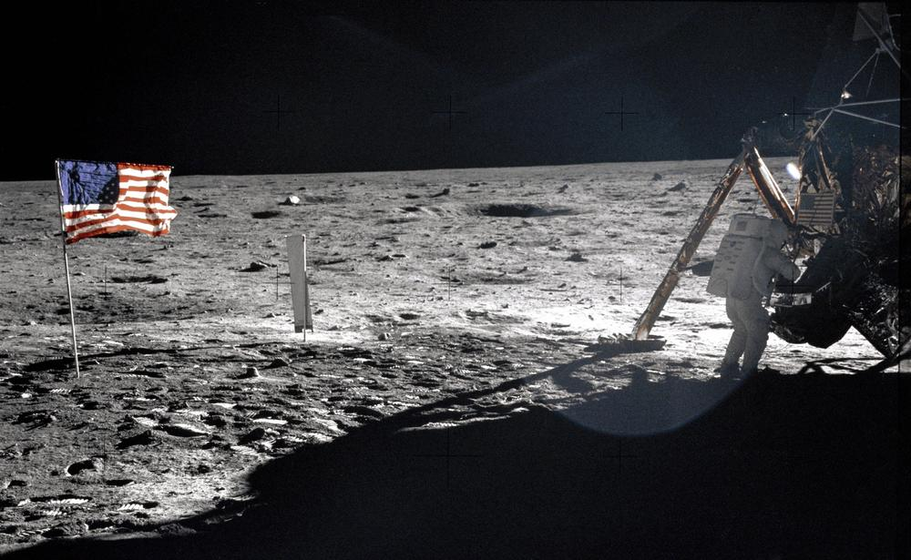 """In this July 20, 1969 photo provided by NASA shows Apollo 11 astronaut Neil Armstrong on the lunar surface. Apollo 11 astronauts trained on Earth to take individual photographs in succession in order to create a series of frames that could be assembled into panoramic images. This frame from Aldrin's panorama of the Apollo 11 landing site is the only good picture of mission commander Neil Armstrong on the lunar surface. The family of Neil Armstrong, the first man to walk on the moon, says he has died at age 82. A statement from the family says he died following complications resulting from cardiovascular procedures. It doesn't say where he died. Armstrong commanded the Apollo 11 spacecraft that landed on the moon July 20, 1969. He radioed back to Earth the historic news of """"one giant leap for mankind."""" Armstrong and fellow astronaut Edwin """"Buzz"""" Aldrin spent nearly three hours walking on the moon, collecting samples, conducting experiments and taking photographs. In all, 12 Americans walked on the moon from 1969 to 1972. (AP Photo/NASA, Buzz Aldrin) AP Photo/NASA, Buzz Aldrin"""