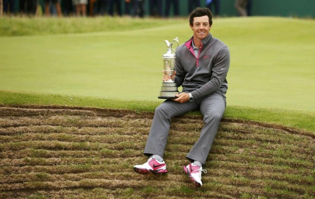 Rory McIlroy of Northern Ireland sits on the edge of a bunker as he holds the Claret Jug after winning the British Open Championship at the Royal Liverpool Golf Club in Hoylake, northern England July 20, 2014. REUTERS/Cathal McNaughton (BRITAIN - Tags: SPORT GOLF) Cathal Mcnaughton/Reuters
