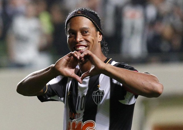 FILE - In this July 11, 2013 file photo, Brazil's Atletico Mineiro's Ronaldinho celebrates his team's victory over Argentina's Newell's Old Boys at the end of a Copa Libertadores semifinal soccer match in Belo Horizonte, Brazil. The Brazilian soccer midfielder is putting his Rio de Janeiro mansion on the rental market during the last half of the World Cup. The real estate agency handling the property says on its website that the five-bedroom house is available for the first 15 days of July for $15,522 a day. (AP Photo/Bruno Magalhaes, File) AP Photo/Bruno Magalhaes, File