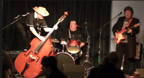 Benefits cheat rumbled after YouTube videos show him jumping around on stage with his band