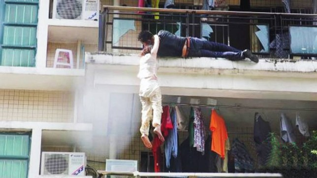 """Pic shows: People help man Meng Lui and his girlfriend Mei KennA heated row between a young Chinese couple narrowly avoided becoming a disaster after the pair tried to kill themselves first of all by slashing their wrists, then by blowing themselves up and finally by jumping off the building.nnMeng Liu, 26, and girlfriend Mei Ke, 25, had had a furious row over the fact that he had been out the night before with friends and not come home until late.nnAfter a heated argument they had reportedly decided to separate, but then fell into each other's arms and declared that although they couldn't live together and they couldn't live without each other either, and therefore they planned to die together.nnAccording to police spokesman De Li, the couple had first smashed a bottle and used a piece of glass to cut their wrists. But the cuts had not been deep enough and when they were still alive 20 minutes later, they switched on the gas oven and waited for the gas to fill the flat before lighting a match. But this also failed to kill them as the mixture was too thin to start an explosion.nnHe said: """"They then decided to jump to their deaths and climbed onto the other side of the balcony in their flat. They were both holding each other and went to jump but at the last minute he changed his mind and grabbed onto the railings, and as she had her hands around his neck she also ended up hanging from him. Both of them were screaming for help, which alerted people below who called firemen who then broke into the flat and first of all grabbed the young woman who was still clinging on with the last of her strength.nn""""They then grabbed the man and helped him back to the right side, after which the couple fell into each other's arms and declared their love for each other.""""nnThe pair now face charges over the attempt to blow up the flat and police in the city Zhuhai in south-eastern China's Guangdong province, where the incident happened, said a report had been handed to prosecutors.nn(en"""