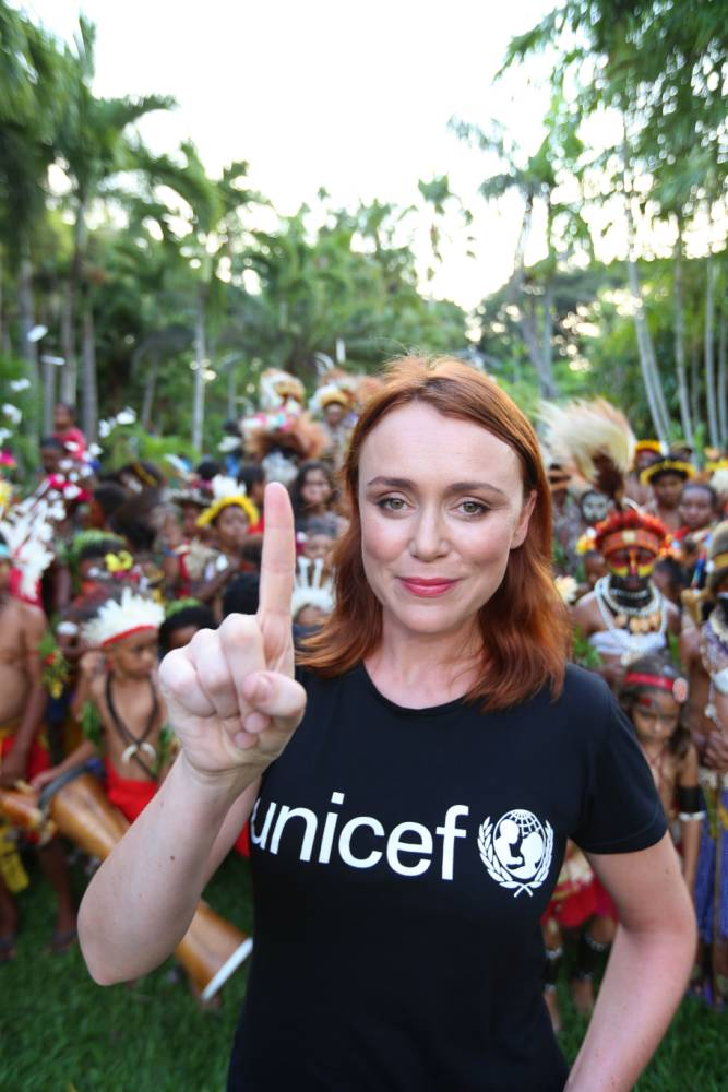 Actress Keeley Hawes recently travelled to Papua New Guinea, sleeping in a tree and travelling by wooden boat for six hours to deliver vaccines to remote villages for Unicef. Footage of the trip will be featured during the Commonwealth Games on Wednesday, the first time such a charity video has been included Credit: UNICEF 2014 / James Alcock