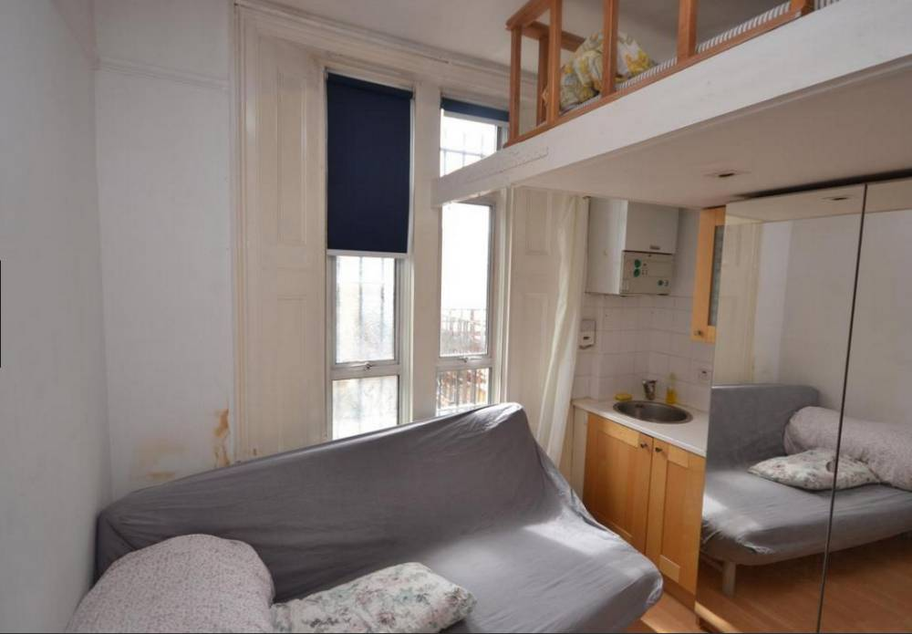 Kentish Town studio flat for rent at £780 per month with bed two feet from the ceiling More than 50 people have enquired about renting a £780-a-month studio flat in London so small would-be tenants have to climb up above the fridge just to get into bed. The scramble for the studio flat with a 'mezzanine-level bed in Kentish Town is being seen as the latest evidence of a shortage in rental accommodation in the capital. At 9ft by 8ft the studio's main room, converted from a single room in a terraced house, is barely bigger than the average prison cell. It also includes a tiny ensuite toilet with a second sink squeezed in the corner. Would-be tenants are also at risk of bumping their heads as there is less than 2ft of space between the mattress and ceiling. credit: RightMove