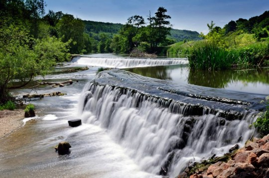 Long exposure of waterfalls at Warleigh Weir near Claverton in Somerset, taken on June 24, 2013. (Photo by Rod Lawton/N-Photo Magazine via Getty Images)