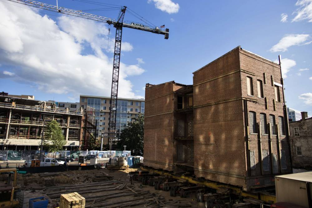 We're moving home! Three-storey 112-year-old house rolled away on wheels