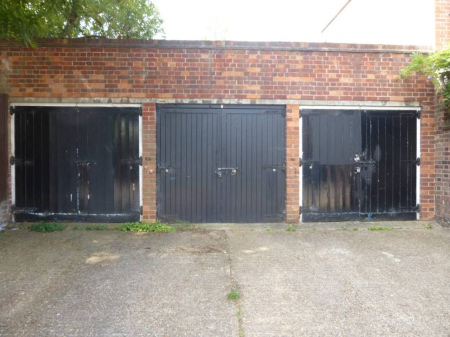 This row of three garages on Blenkarne Road, London, which have sold for £500,000. (See SWNS story SWGARAGES) An auction house was left stunned when three garages sold for a staggering £500,000 - despite having NO planning permission. The row of garages near Wandsworth Common, south-west London, were offered with a guide price of around £130,000. But there was a bidding frenzy when the lot went under the hammer at Barnard Marcus Auction on Great Queen Street, London. Investors in the saleroom and on the phone battled it out for the freehold garages, which have parking at the front and are built on the side of a semi-detached family home. The winning bidder ended up paying #500,000 for the three garages - which is almost THREE TIMES the average price paid for a home in England and Wales last month. The garages are located on Blenkarne Road, to the rear of 13 Thurleigh Road, and between Wandsworth and Clapham Commons.