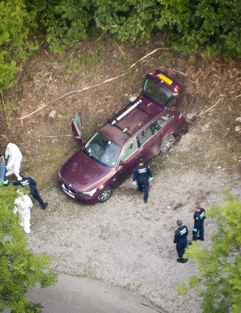 Aerial photo of the car at the murder scene in the forrest near Chevaline and Lake Annecy in the French Alps. Mr Saad al-Hilli, his wife, Iqbal, and a 74-year-old woman who held a Swedish passport and who is reported to be Mr al-Hilli's mother-in-law, were killed during the attack in Chevaline, close to the tourist destination of Lake Annecy, on Wednesday. The fourth victim, a cyclist whose body was found near the car after apparently stumbling across the attack, has been named as 45-year-old Sylvain Mollier. The al-Hillis' four-year-old daughter, Zeena, spent eight hours hiding in the car where her parents died before being found by officers. Police said she had hidden under her mother's skirt when the shooting started. Her sister, seven-year-old Zainab, remains in a medically-induced coma in Grenoble University Hospital after being shot in the shoulder and beaten around the head.  . REXMAILPIX.