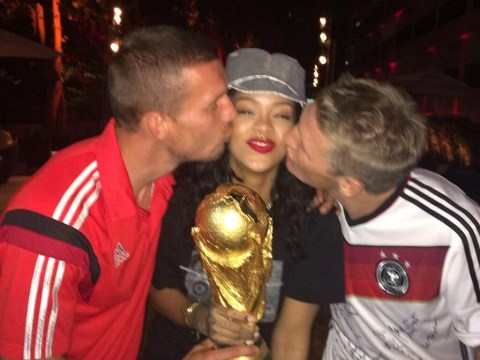 Rihanna celebrates with victorious German stars Mario Gotze, Bastian Schweinsteiger and co – and TOUCHES the World Cup trophy