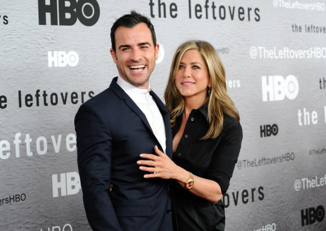 """Actors Jennifer Aniston, right, and Justin Theroux attend HBO's """"The Leftovers"""" season premiere at the NYU Skirball Center on Monday, June 23, 2014 in New York. (Photo by Evan Agostini/Invision/AP) Evan Agostini/Invision/AP"""