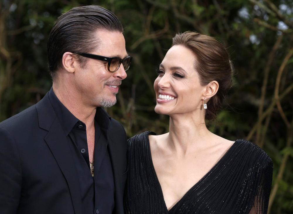 Actor Brad Pitt and actress Angelina Jolie arrive for a special Maleficent Costume Display at Kensington Palace in London in this May 8, 2014 file photo