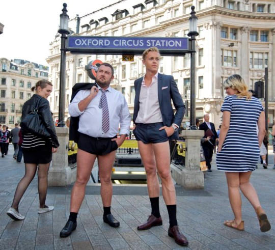 LONDON, UNITED KINGDOM: JULY 29: Two models seen here at Oxford Circus in short shorts on July 29, 2014, in London, England. Dress down Friday?  Thankfully Londoners can now rest easy as the extreme fashion faux-pas, which took Twitter by storm earlier this week, has now been revealed as an elaborate marketing stunt by Channel 4 to launch its new original Shorts programmes which are available to watch on the move, exclusively on Channel 4ís on-demand service, 4oD. The broadcaster engaged a tailor, who spent two weeks creating the bespoke 'barely there' bum huggers, and then deployed a team of brave male models to frequent City hotspots ñ kitted out in cringeworthy, buttock-revealing micro suit shorts. PHOTOGRAPH BY Rosie Hallam / Barcroft Media UK Office, London. T +44 845 370 2233 W www.barcroftmedia.com USA Office, New York City. T +1 212 796 2458 W www.barcroftusa.com Indian Office, Delhi. T +91 11 4053 2429 W www.barcroftindia.com