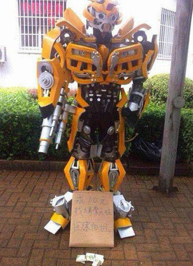 Chinese beggar dressed as Transformer Bumblebee deserves more than he gets