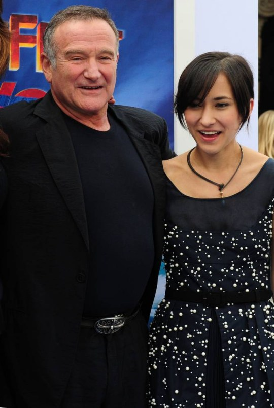 Actor Robin Williams and his daughter Zelda pose on arrival for the world premiere of the movie 'Happy Feet Two' in Hollywood on November 13, 2011 in southern California. Happy Feet Two will presented in RealD 3D and IMAX 3D, and also in 2D, on November 18, 2011. AFP PHOTO / Frederic J. BROWN (Photo credit should read FREDERIC J. BROWN/AFP/Getty Images)