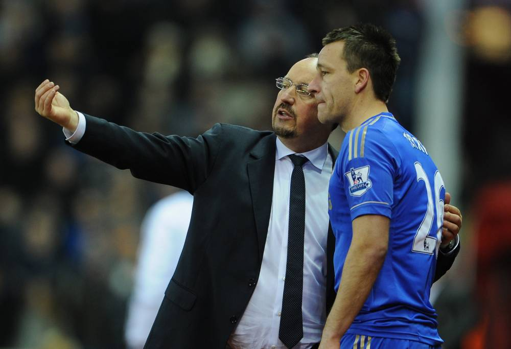 STOKE ON TRENT, ENGLAND - JANUARY 12:  John Terry of Chelsea receives instructions from Manager Rafael Benitez during the Barclays Premier League match between Stoke City and Chelsea at the Britannia Stadium on January 12, 2013, in Stoke-on-Trent, England.  (Photo by Michael Regan/Getty Images)
