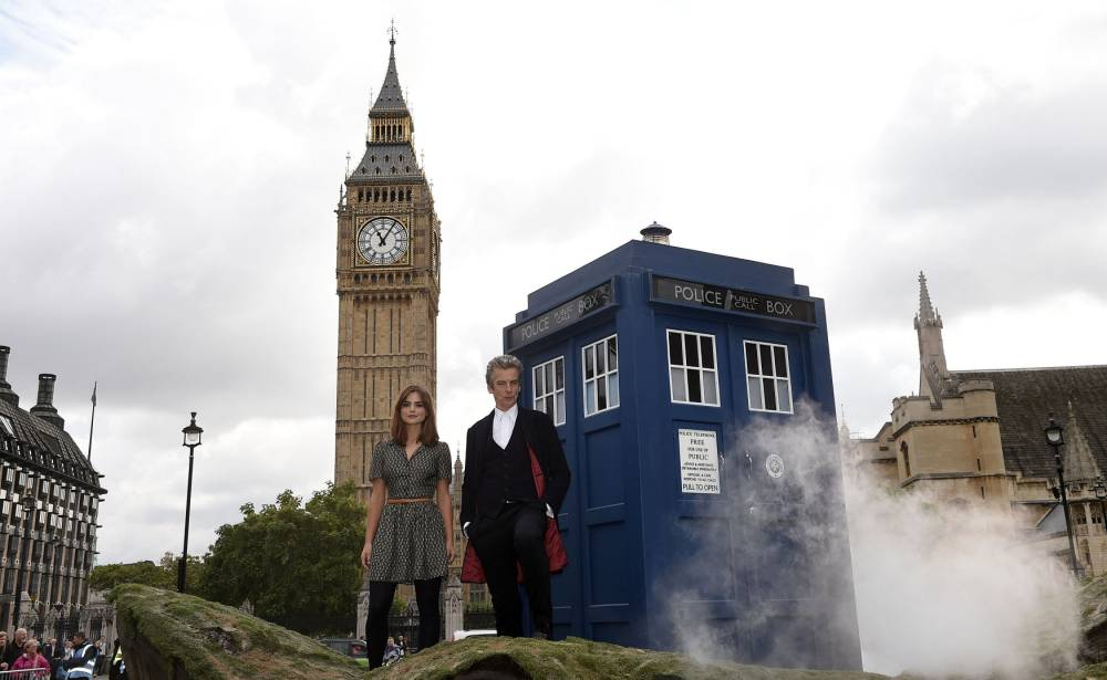Doctor Who stars Peter Capaldi and Jenna Coleman during a photocall for Doctor Who at Parliament Square, central London. PRESS ASSOCIATION Photo. Picture date: Friday August 22, 2014. See PA story SHOWBIZ Who. Photo credit should read: Ian West/PA Wire