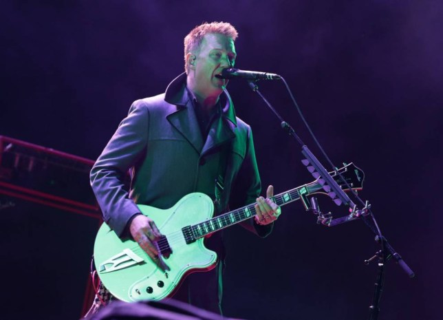 EDITORIAL USE ONLY Josh Homme of Queens of the Stone Age performing on the Main Stage, at the Reading Festival, at Little John's Farm on Richfield Avenue, Reading. PRESS ASSOCIATION Photo. Picture date: Friday August 22, 2014. Photo credit should read: Yui Mok/PA Wire