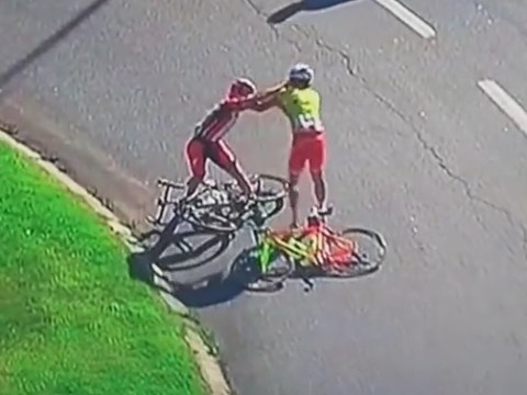 Cyclists Vicente de Mateus and Enrico Rossi come to blows during Volta a Portugal