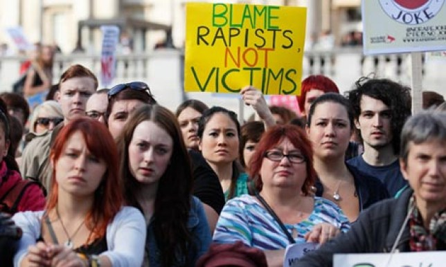The former judge has been accused of contributing to the women-blaming culture of rape, something anti-rape campaigners, seen here, have long protested against (Picture: Getty Images)