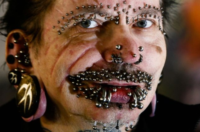 Rolf Buchholz, who has a record 453 piercings, was turned away from Dubai airport (Picture: (AP Photo/Markus Schreiber)