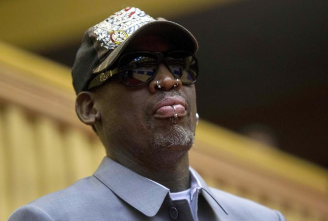 Thousands of people now believe Dennis Rodman is trying to persuade IS to stop their campaign, even though the article reporting it was a spoof (Picture: AP)