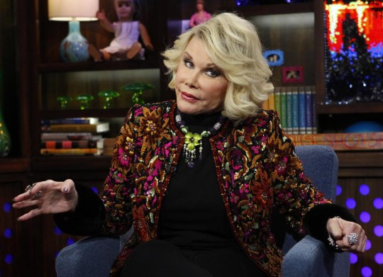 """In this Feb. 16, 2012 photo provided by Bravo, Joan Rivers appears on the """"Watch What Happens Live"""" show in New York. Rivers, the raucous, acid-tongued comedian who crashed the male-dominated realm of late-night talk shows and turned Hollywood red carpets into danger zones for badly dressed celebrities, died Thursday, Sept. 4, 2014. She was 81. Rivers was hospitalized Aug. 28, after going into cardiac arrest at a doctor's office. (AP Photo/Bravo, Peter Kramer, File) AP Photo/Bravo, Peter Kramer, File"""