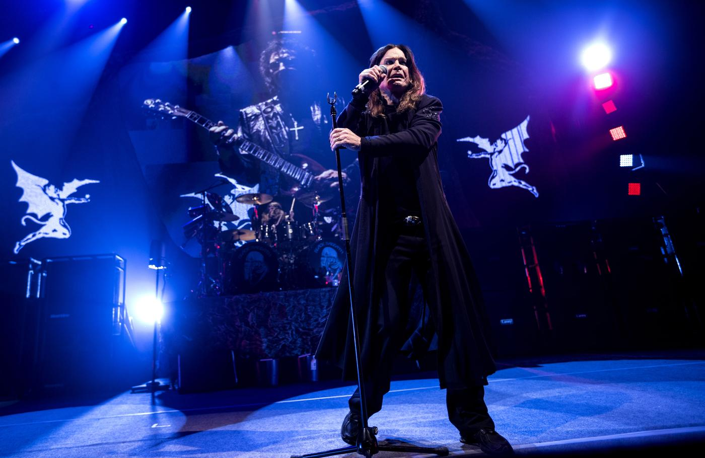 Singer Ozzy Osbourne of British rock band Black Sabbath, performs with guitarist Tony Iommi, seen on screen behind, during a concert Tuesday Nov. 26, 2013, at Forum Arena in Copenhagen, Denmark. (AP Photo/Mikkel Berg Pedersen, Polfoto ) DENMARK OUT