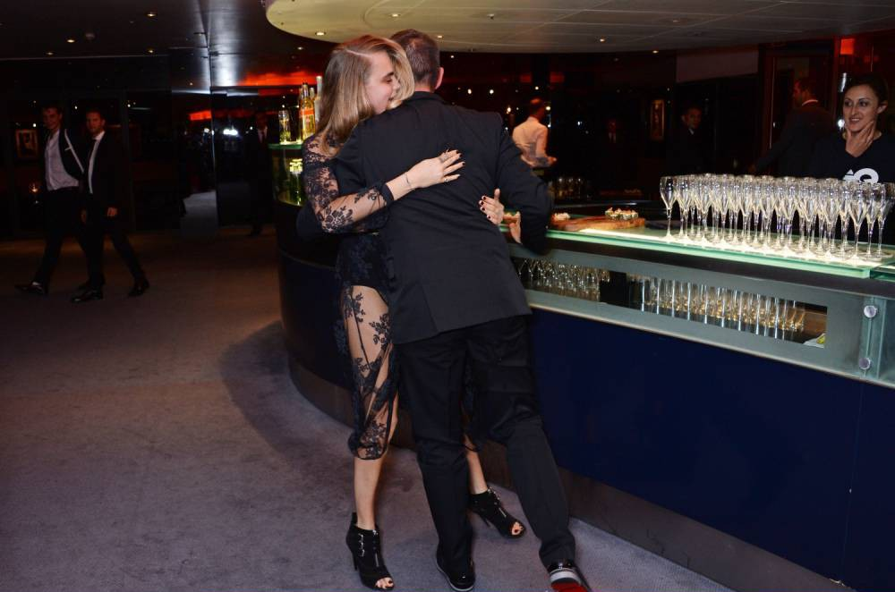 LONDON, ENGLAND - SEPTEMBER 02:  Cara Delevingne (L) and Jonathan Saunders attend the GQ Men Of The Year awards in association with Hugo Boss at The Royal Opera House on September 2, 2014 in London, England.  (Photo by David M. Benett/Getty Images)