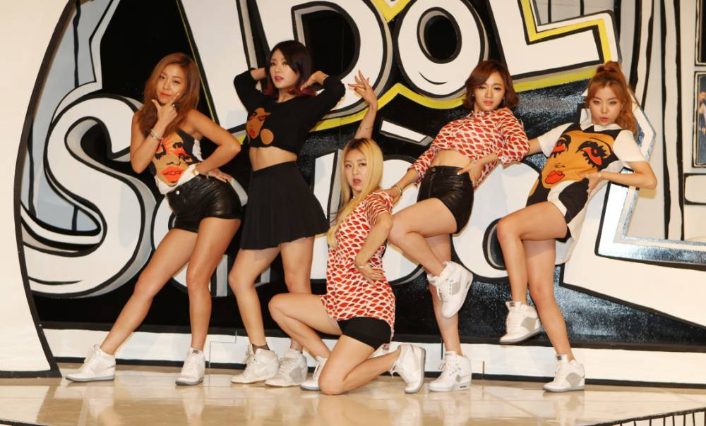 """SEOUL, SOUTH KOREA - AUGUST 26:  LADIES' CODE pose for photographs during the MBC Music """"Idol School"""" press conference at Digital Magic Space on August 26, 2014 in Seoul, South Korea.  (Photo by ilgan Sports/Multi-Bits via Getty Images)"""