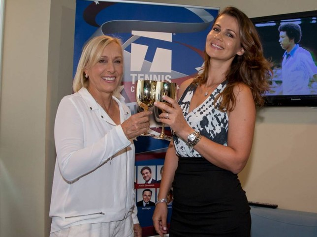 """In this Saturday, Sept. 6, 2014 photo provided by cameraworkusa, Martina Navratilova, left, and Julia Lemigova celebrate their engagement at Arthur Ashe Stadium in New York. Navratilova tweeted after the proposal: """"Thanks everyone for your good wishes- I am very happy, so is Julia and our whole family:)"""" (AP Photo/cameraworkusa, Fred and Susan Mullane)"""