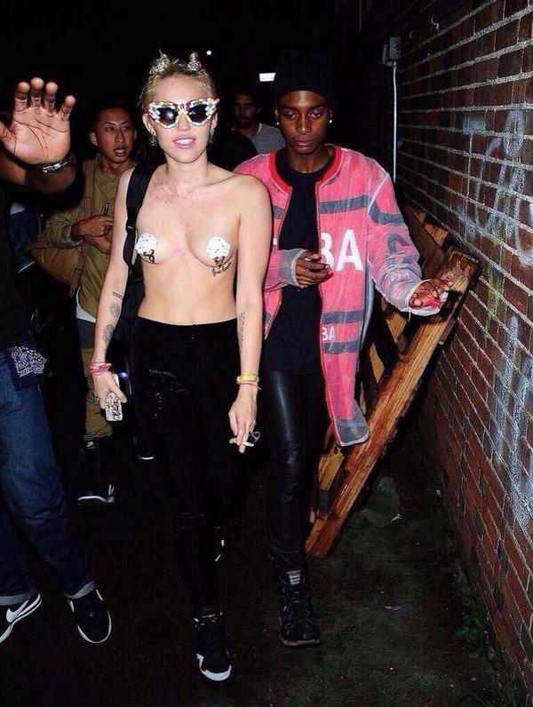 Topless Miley Cyrus wears novelty nipple tassels to Vera Wang party for New York Fashion Week