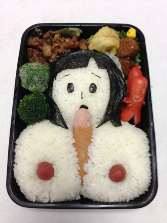 "Pic shows: Woman Motoko Taketou created his husband a specially modified pornographic Bento box for lunch as revenge.nnA Japanese woman fed up with her husband staying up until late at night looking at porn on the computer is likely to get a rude awakening when he opens this lunchbox.nnMotoko Taketou reportedly clashed with husband Sakutarou frequently after he spent hours in the evening looking for sites instead of spending time with her.nnIt also made him tired and late for work and she complained that he wasn't taking his career seriously.nnSo after another late-night session, knowing that her husband would be tired and not paying attention in the morning, she created him a specially modified pornographic Bento box for lunch.nnShe then posted on Twitter saying: ""I wonder how my husband will explain this to colleagues.""nnBento is a single-portion takeout or home-packed meal common in Japanese cuisine. A traditional bento holds rice, fish or meat, with pickled or cooked vegetables, usually in a box-shaped container. Japanese were will often make Bento boxes for children or husbands, although not usually with such creativity.nnThis particular Bento box image ended up going viral in Japan, including the woman's comment that she hadn't had time to make the fried eggs. She didn't specify how they would have fitted into the artwork.nn(ends)n"