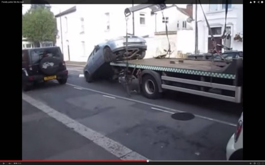 Penalty parker hits the road Driver reverses his car from the back of a tow truck in a fit of anger and drives away Waltham Forest Council